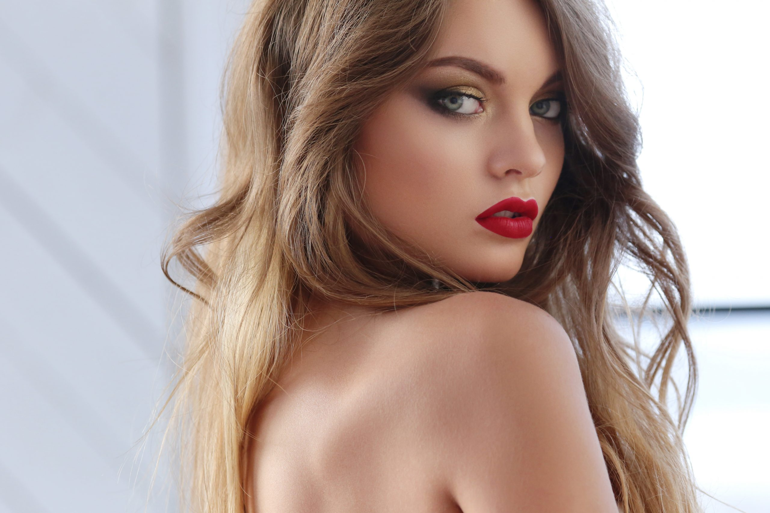 Beautiful woman with blonde hair and red lipstick